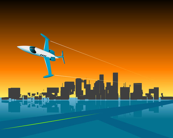 private business jet flying by a city at sunset