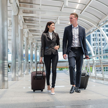 business travelers conversing while walking